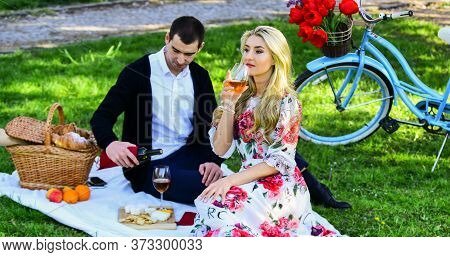 Romantic Picnic Date With Wine. Enjoying Their Perfect Date. Happy Loving Couple Relaxing In Park. C