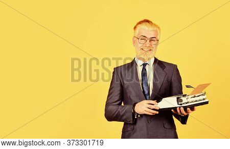 Successful Businessman Use Retro Typewriter. Mature Man Dyed Beard Hair. Professional Typist Make No