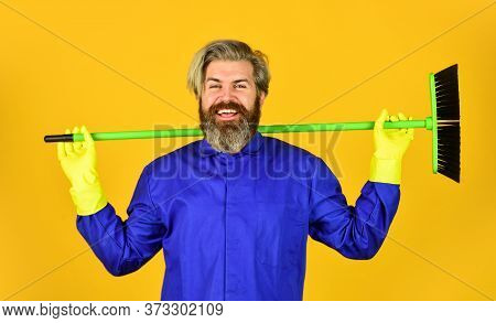 Man Cleaner. Bearded Man Cleaning With Mop. Janitor In Gloves. Husband Cleaning House. Housework And