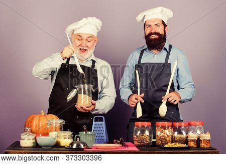 Cooking With Passion. Healthy Food Cooking. Mature Senior Bearded Men In Kitchen. Halloween Recipe.