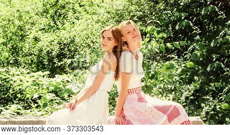 Friendship Concept. Girls Friends Nature Background. Enjoy Pleasant Society. Revelation And Sincerit