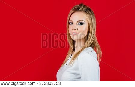 Natural Decorative Cosmetics. Fashion Model With Perfect Skin. Sexy Blonde Woman On Red Background.