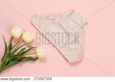 Cotton Panties With Tulip Flowers On A Pink Background. Woman Underwear Set. Top View.