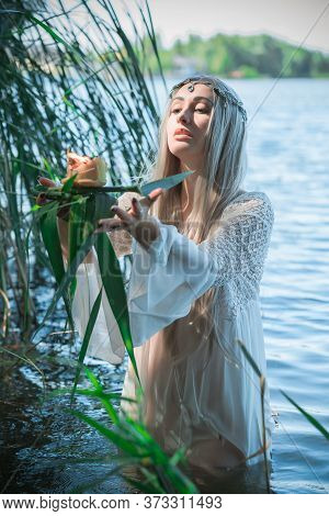 Old European Magic, Mystical Pagan Scene, Woman In Lake, Rituals. Magic Divination By Candle Of Wax