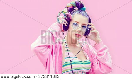Portrait Of Cool Teenage Girl With Trendy Hairstyle Listening Music On Big Headphones - Young Fashio