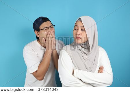 Muslim Couple Having Conflict, Husband Trying To Resolve, Persuade And Apologize To His Wife After F