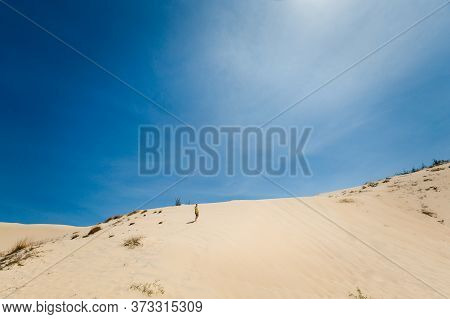 Young Man On White Sand Dunes In Vietnam