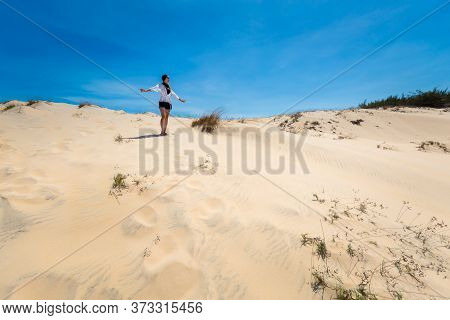 Happy Woman On White Sand Dunes In Vietnam