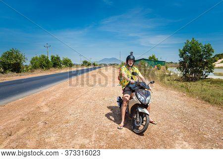 Local Landmark Of Tourist On Motorbike Taken During Vietnam Coastal Trip From La Gi To Phan Tiet. La
