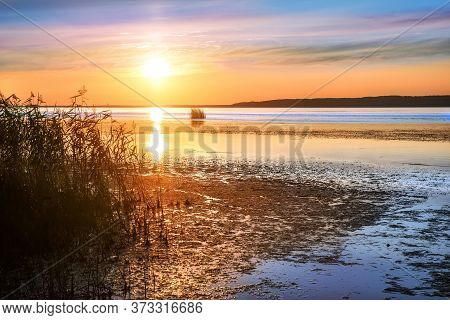 Galich Lake In The Kostroma Region And The Setting Sun With Reflection In The Thickets Of Reeds