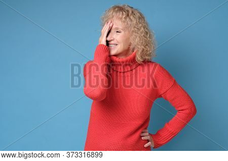 Female Mid Adult Woman Laughing Covering Her Face Feeling Shy.