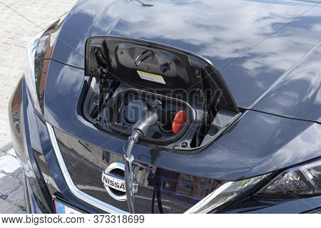 Sint Gillis Waas, Belgium, August 16, 2019, Close Up Of An Electric Car That Is Charging