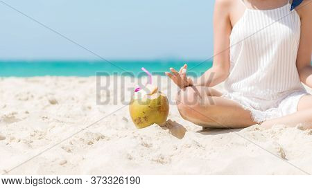 Summer Vacation. Lifestyle Tourism Woman  Relax And Yoga Pose Balance Body Vital  Zen And Meditation