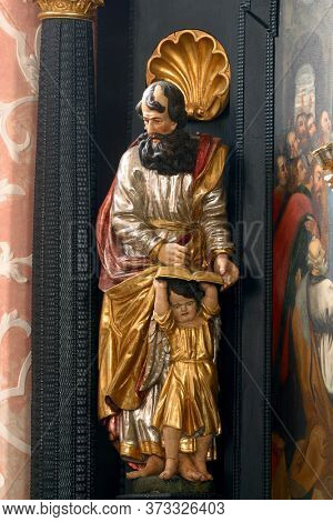 ZAGREB, CROATIA - MAY 16, 2013: Saint Matthew the Evangelist, statue on the altar of the Holy Spirit in the Church of Saint Catherine of Alexandria in Zagreb, Croatia