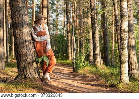 Portrait Of Woman Botanist With Backpack On Ecological Hiking Trail In Forest. Naturalist Exploring