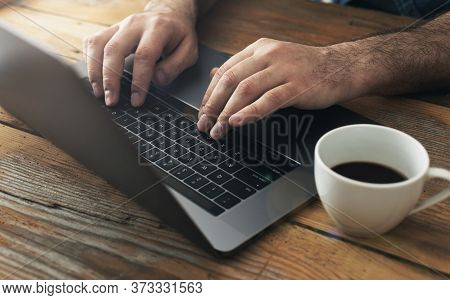 Man Using Laptop In Home Office Male Hands Typing On Keyboard