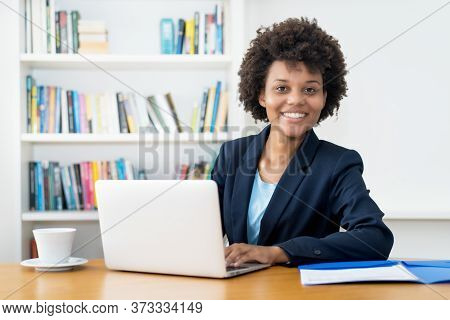 Pretty African American Business Trainee Working At Computer Indoors At Home Or At Office