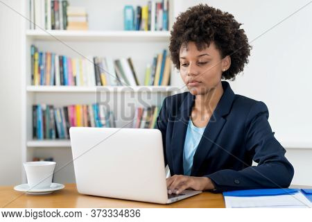 Beautiful African American Business Trainee Working At Computer Indoors At Home Or At Office