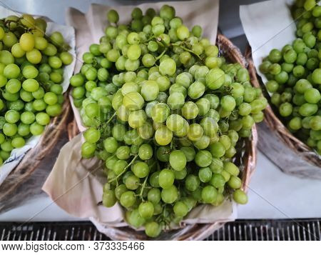 High Angle View Of Bunch Of Fresh Green Seedless Grape Fruit For Sale