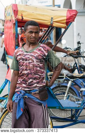 Toliara, Madagascar - January 10th, 2019: Portrait Of A Male Malagasy Pousse Pousse Driver In Toliar