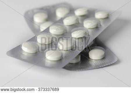 Pharmaceuticals Pills Medicine On White Background. Capsule Pill Medicine. White Medical Pills And T