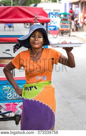 Toliara, Madagascar - January 10th, 2019: A Local Malagasy Woman Selling Food The Streets At The Mar