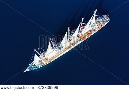 Aerial View At The Cruise Ship With Sail. Adventure And Travel.  Landscape With Cruise Liner On Adri