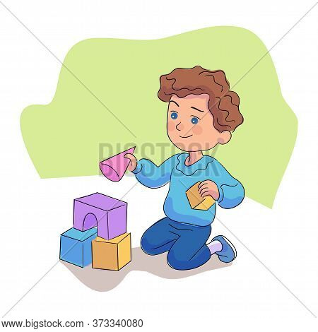 Little Happy Boy Playing With Building Blocks. Cute Kid Building Toy Castle Big Tower From Colorful