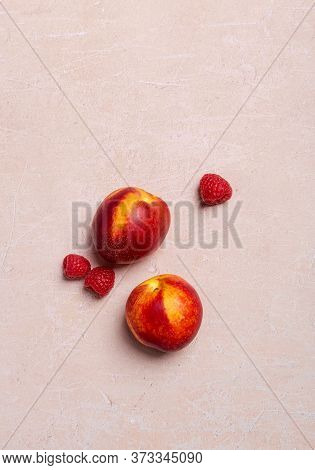 Peaces And Raspberry On Pink Concrete Background. Top View, Flat Lay, Free Space For Text And Sale