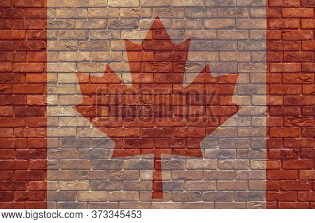 Canada Flag On A Brick Wall. Grunge Wall With A Flag. Related To Canada National Day July 1. Rustic