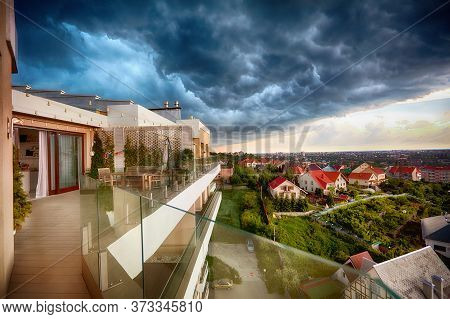 A Heavy Thunderstorm Is Coming . Dark Clouds Approaching The City