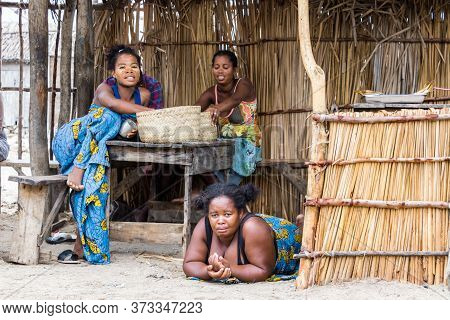 Andavadoaka, Madagascar - January 13th, 2019: Three Malagasy Women Selling Food Placed On Wooden Tab