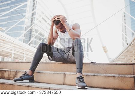 A 31 Year Old African American Man With Black Skin He Is And Athlete, He Is Stressed And Headache Wh