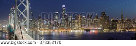 San Francisco Bay Bridge And Skyline At Night. Yerba Buena Island, San Francisco, California, Usa.