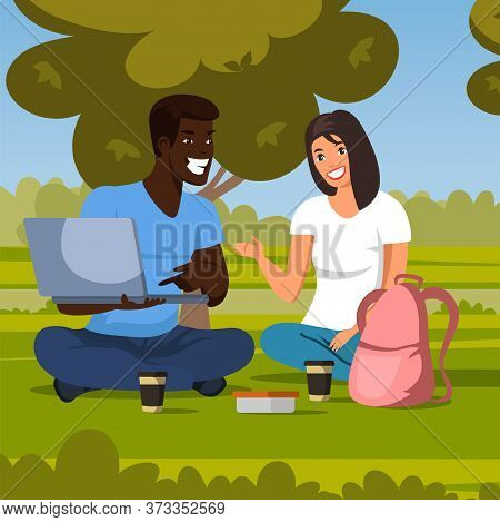Happy Smiling Afro-american Man And Caucasian Woman Teenagers Watching Funny Video On Laptop Sitting