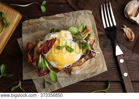 Delicious Egg Benedict Served On Wooden Table, Flat Lay