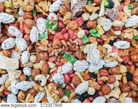 A Multi-colored Mixture Of Nuts, Dried Fruits And Berries On The Counter Of The Farmers Market. Heal