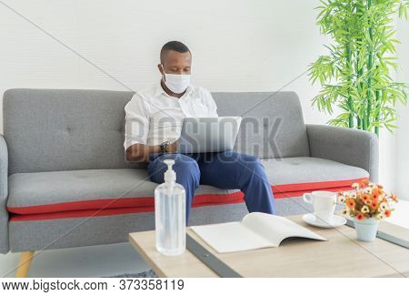 Portrait Of Ill Black American Man Wearing A Face Mask For Corona Virus And Health Care Concept Work