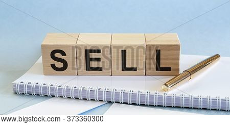 Concept Sell Word Inscription On Office Table. Selling Concept