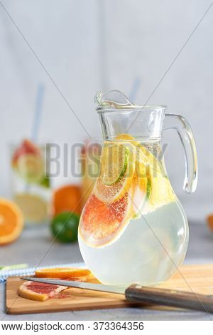 Health Care, Fitness, Healthy Nutrition Diet Concept. Fresh Cool Homemade Citrus Infused Detox Water