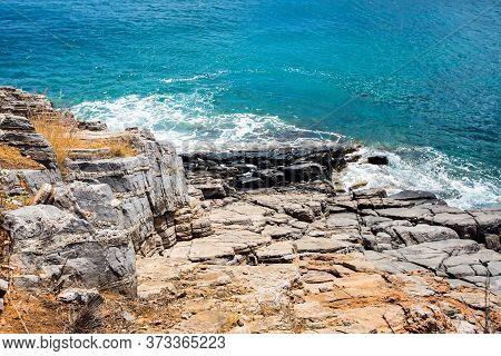 Cliff. Rocky Shore Of Mediterranean Sea. Waves Striking On Cliffs.