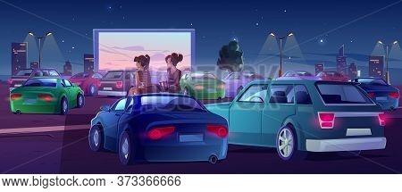 Girls At Car Cinema. Couple Of Friends In Drive-in Theater With Automobiles Stand In Open Air City P