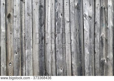 Weathered Wooden Wall Texture. Old Wooden Fence. Background Of Old Retro Vintage Aged Texture. Gray