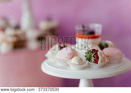 Dessert Table With Panna Cotta, Meringues And Strawberry In White Chocolate. Dessert. Dessert Table