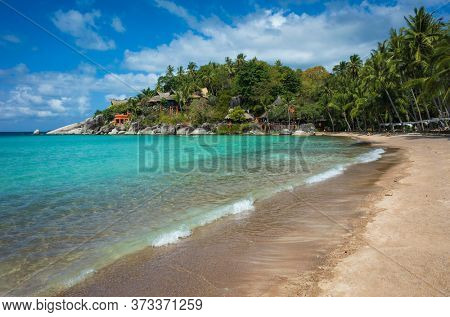 Tropical island paradise turquoise clear water at Sairee beach on Koh Tao, Thailand