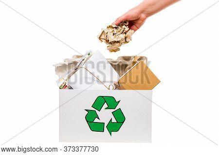 Female Hand Putting Wastepaper In Recycling Bin