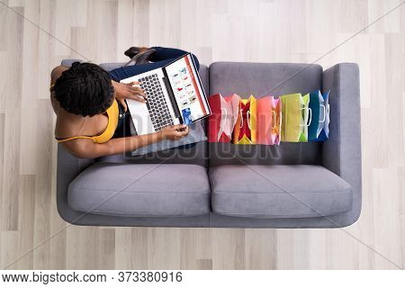 African American Shopping Online On Ecommerce Website Using Laptop