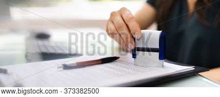 Record Or Permit Document Paper Stamper In Office