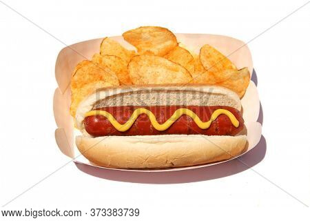 Hot Dog. Hot Dog with Mustard, Potato Chips. Isolated on white. Room for text. Hot Dogs are a perfect meal for any Lunch.