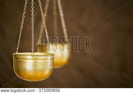 Business Balance Concept, Gold Weighing Scales On Brown Background